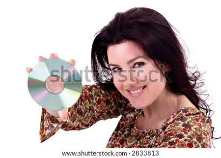 Beautiful young woman holding a CD / DVD / Media Disc. - stock photo