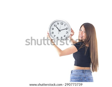 Beautiful young woman holding a clock against a white background - stock photo