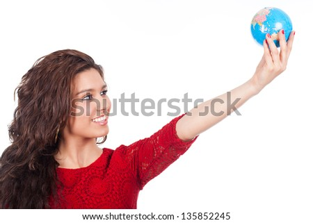 beautiful young woman holding a globe in hand - stock photo