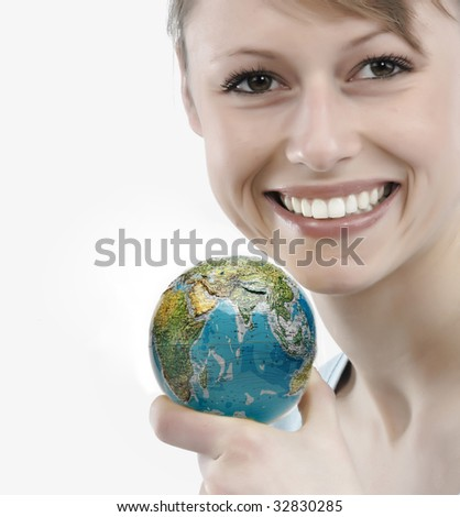 Beautiful young woman holding a green apple - stock photo