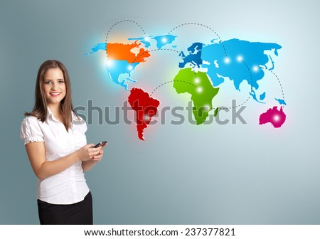 Beautiful young woman holding a phone and presenting colorful world map - stock photo