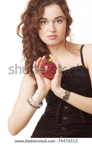 Beautiful young woman holding a red apple against white background