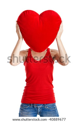 Beautiful young woman holding a red heart, Valentine concept