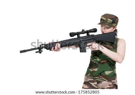Beautiful young woman holding an automatic assault rifle - stock photo