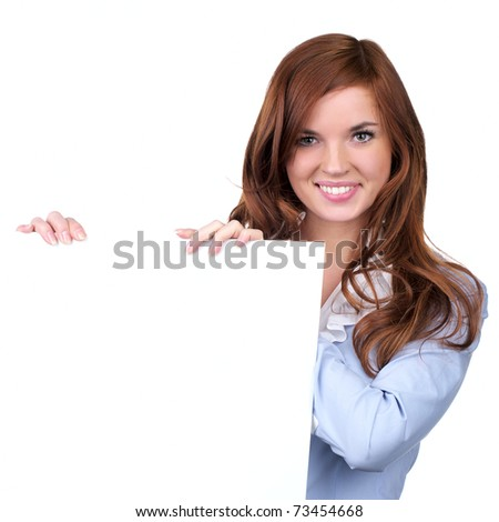Beautiful young woman holding an empty billboard over white background - stock photo
