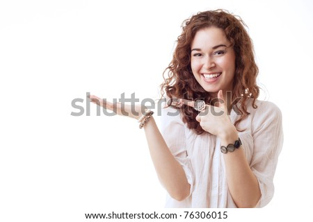 Beautiful young woman holding and showing an empty space on white background