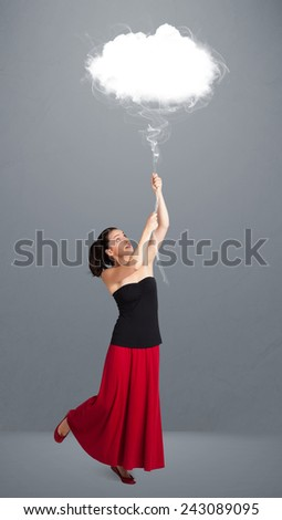 Beautiful young woman holding cloud - stock photo