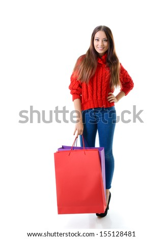 beautiful young woman holding colored shopping bags and gift box, holiday seasonal image over white