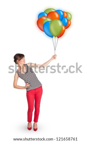 Beautiful young woman holding colorful balloons