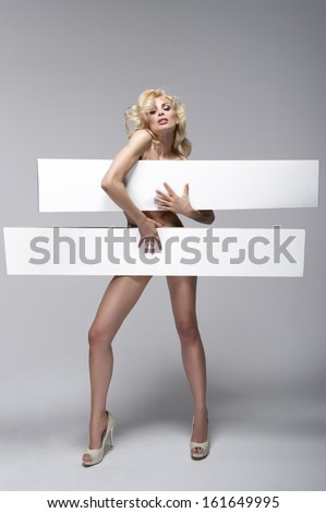 Beautiful young woman holding empty white board  - stock photo
