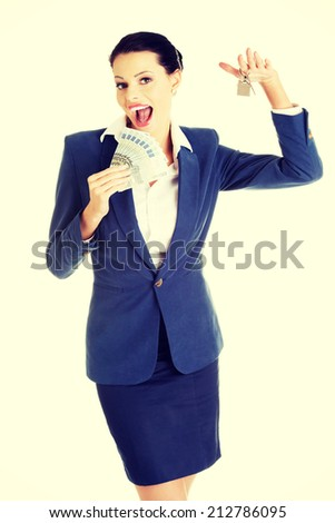 Beautiful young woman holding euro and house keys over white - real estate loan concept - stock photo