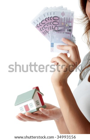 Beautiful young woman holding euros bills and house model over white