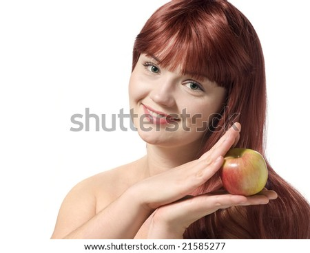 Beautiful young woman holding fresh apple, isolated over white - stock photo