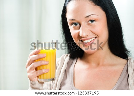 Beautiful young woman holding glass of orange juice,Healthy refreshment - stock photo