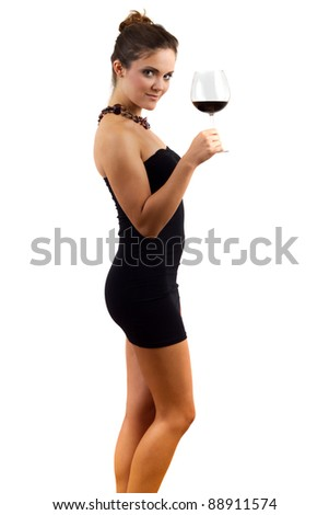 Beautiful young woman holding glass of red wine - stock photo