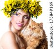 Beautiful young woman holding Persian cat - stock photo