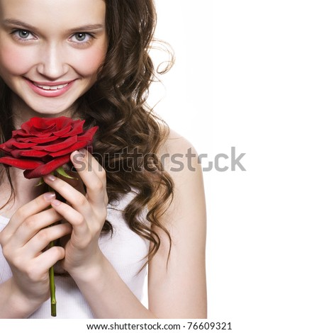 beautiful young woman holding red rose. Space for text. - stock photo