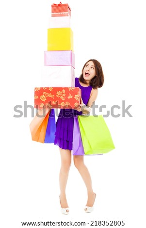beautiful young woman holding shopping bag and gift boxes over white background - stock photo