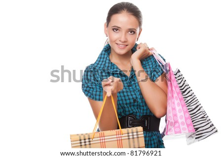 beautiful  young woman holding shopping bags isolated on white background - stock photo