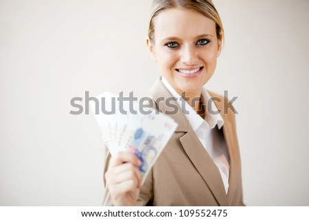 beautiful young woman holding south african money - stock photo