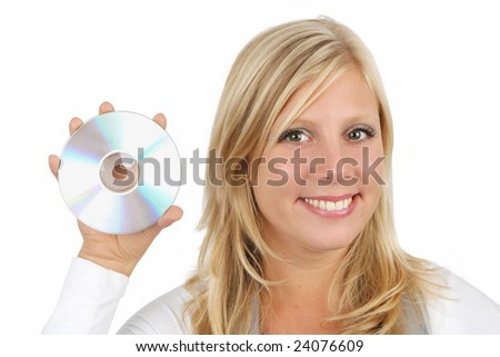 Beautiful young woman holding up a disc (CD, DVD or Blu-ray) against a white background. - stock photo