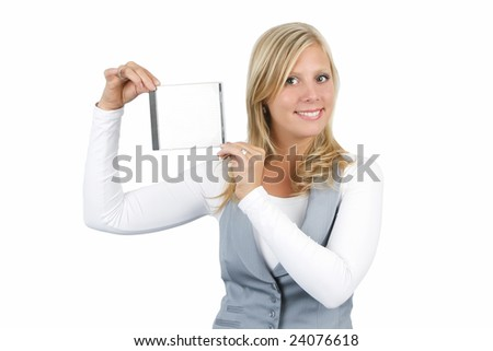Beautiful young woman holding up a jewel case for a CD, DVD or Blu ray disc against a white background. - stock photo