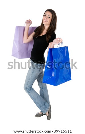 Beautiful young woman holding up shopping bags, happy and smiling, isolated on white background - stock photo