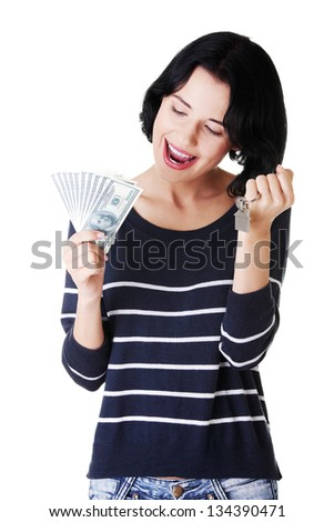 Beautiful young woman holding US dollars bills and house keys over white - real estate loan concept - stock photo