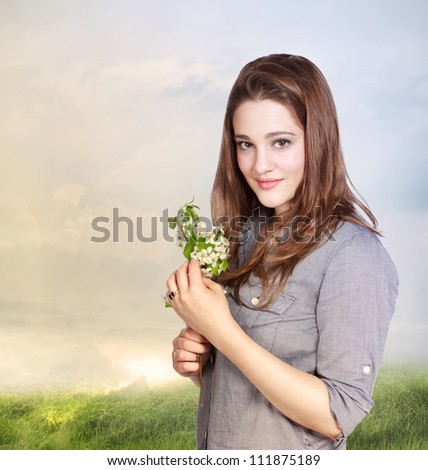 Beautiful Young Woman Holding  White Flowers - stock photo