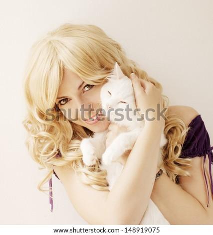 Beautiful young woman holding white Persian cat - stock photo