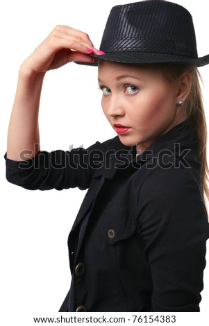 Beautiful young woman holds her hat bolder. Looking to camera.