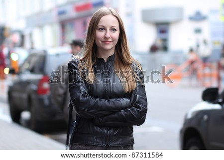 Beautiful young woman in a black leather jacket