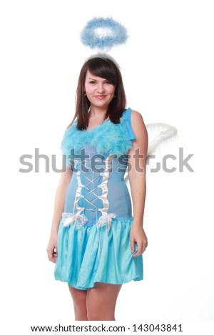 Beautiful young woman in a blue dress angel on Holiday
