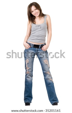 Beautiful young woman in a blue jeans. Isolated - stock photo