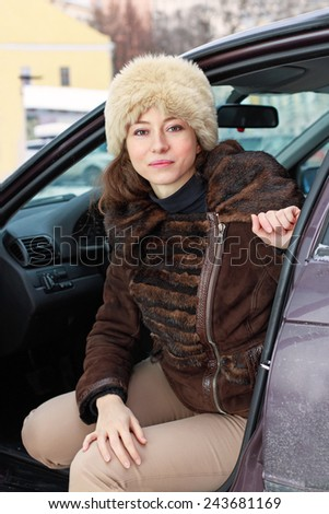 Beautiful young woman in a car