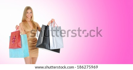 beautiful young woman in a full-length with shopping bags. on pink background - stock photo