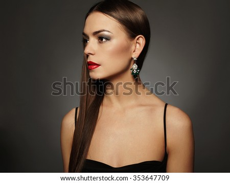 beautiful young woman in a jewelry posing in the studio,luxury.beauty brunette girl with red lips - stock photo
