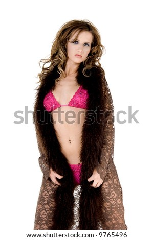 Beautiful young woman in a pink lingerie set and a brown lace robe with angora trim - stock photo