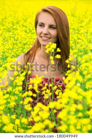 Beautiful young woman  in a raps field - stock photo