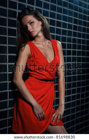 Beautiful young woman in a red dress - stock photo