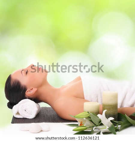 beautiful young woman in a spa - stock photo