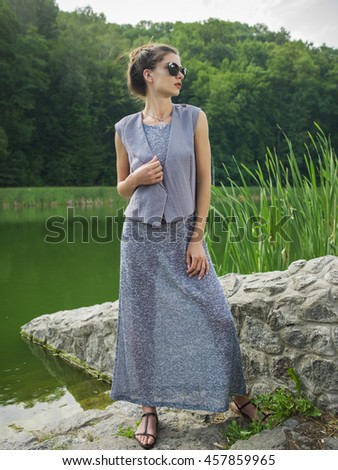 Beautiful young woman in a summer dress. In the park.