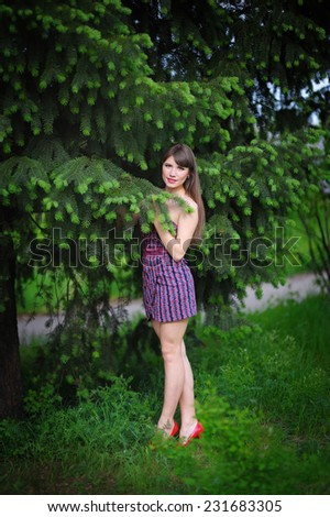 Beautiful young woman in a summer park outdoor portrait close up. - stock photo