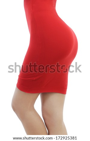 Beautiful young woman in a tight red dress isolated on a white background. Cropped body part - stock photo