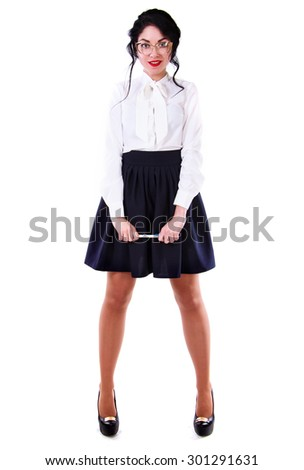 Beautiful young woman in a white blouse and a long blue skirt isolated over white background - stock photo