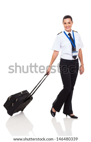 beautiful young woman in airline pilot uniform walking with briefcase on white background - stock photo