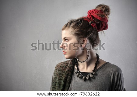 Beautiful young woman in alternative clothes - stock photo