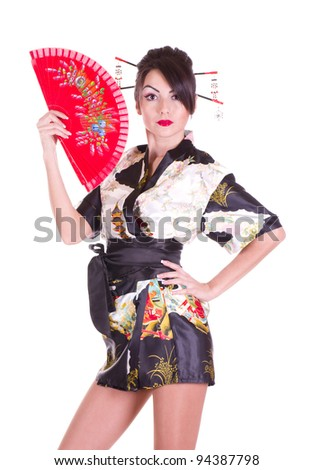 ... in Asian costume with red Asian fan on white background. - stock photo