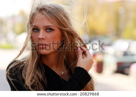 Beautiful young woman in autumnal city