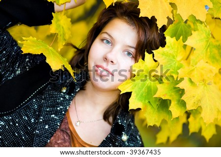 Beautiful young woman in autumnal park